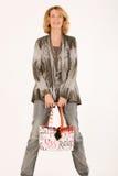Smiling elderly woman with a modern handbag Royalty Free Stock Image