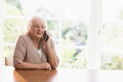 Smiling elderly woman phone calling Stock Photos