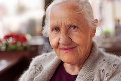 Smiling elderly woman. Portrait sitting in cafe Stock Images