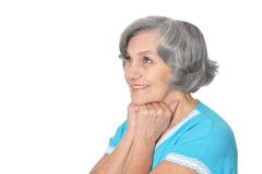 Smiling elderly woman. Portrait of smiling elderly woman on white background Stock Image