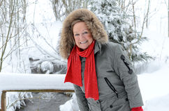 Smiling elderly woman in a winter landscape Royalty Free Stock Photography