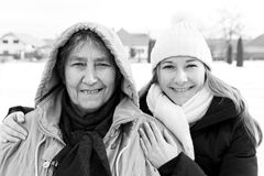 Smiling elderly woman and young caregiver. Photo of happy elderly women and young caregiver Stock Photo
