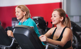 Smiling elderly and young women working out in gym Royalty Free Stock Photography