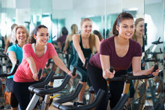 Smiling elderly and young women working out hard Stock Image