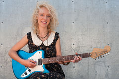 Smiling electric guitar girl Stock Photos