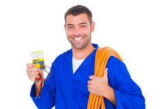 Smiling electrician with rolled wire and multimeter. Portrait of smiling electrician with rolled wire and multimeter on white background Stock Photography