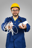 Smiling electrician with tools in hands Stock Image