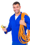 Smiling electrician with wire roll and multimeter Royalty Free Stock Image
