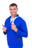 Smiling electrician with wire roll and multimeter Royalty Free Stock Photo