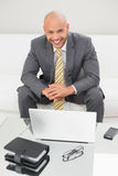 Smiling elegant businessman with laptop at home Royalty Free Stock Photos