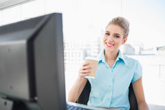 Smiling elegant businesswoman holding coffee Stock Photos