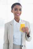 Smiling elegant businesswoman holding glass of orange juice Stock Photos