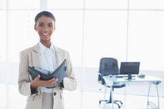 Smiling elegant businesswoman holding her agenda Stock Photos