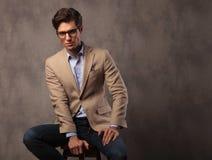 Smiling elegant man sitting in studio Stock Photography