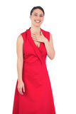 Smiling elegant model in red dress posing Stock Photography