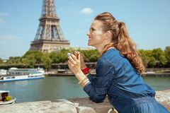 Tourist woman with retro photo camera looking into the distance royalty free stock image