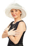 Smiling elegant woman. In satin black dress wearing hat and gloves isolated on white background Royalty Free Stock Photo