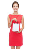 Smiling elegant woman in dress with shopping bag Royalty Free Stock Image