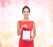 Smiling elegant woman in dress with shopping bag Stock Photos