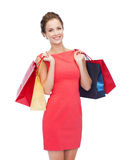 Smiling elegant woman in dress with shopping bags Stock Photos