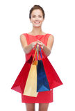 Smiling elegant woman in dress with shopping bags Stock Photography