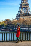 Smiling elegant woman on embankment in Paris, France walking Royalty Free Stock Photos
