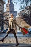Smiling elegant woman in fur coat in Milan, Italy walking Royalty Free Stock Photo