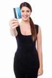 Smiling elegant woman holding credit card Stock Photos