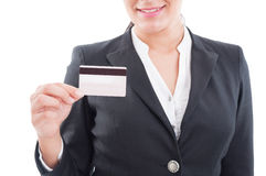 Smiling elegant woman holding a credit or debit card Royalty Free Stock Images