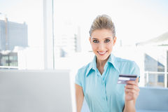 Smiling elegant woman shopping online. In bright office Royalty Free Stock Photo