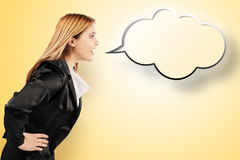 Smiling elegant woman speaking in speech balloon Royalty Free Stock Images