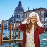 Smiling elegant woman in Venice, Italy wearing Venetian mask. Another world vacation. Portrait of smiling elegant woman in fur hat in Venice, Italy wearing Royalty Free Stock Photos