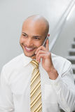 Smiling elegant young businessman using cellphone Stock Image