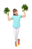Smiling elementary school age girl showing fresh parsley Stock Images