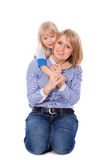 Smiling embracing mom and daughter Royalty Free Stock Photos