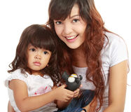 Smiling embracing mom and daughter Stock Photo