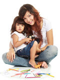 Smiling embracing mom and daughter Stock Photography