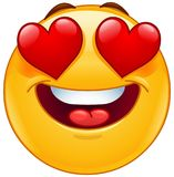 Smiling emoticon face with heart eyes Stock Photos