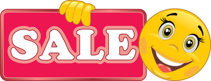 Smiling emoticon holds a Sale sign Royalty Free Stock Images