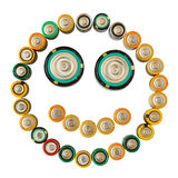 Smiling emoticon made from batteries isolated Stock Photography