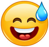 Smiling emoticon with open mouth and cold sweat Stock Photo