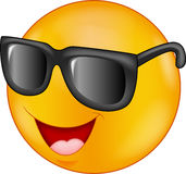 Smiling emoticon wearing sunglasses giving thumb up Stock Photos