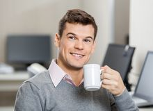 Smiling Employee Having Coffee In Call Center Royalty Free Stock Photography