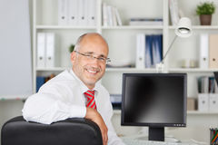 Smiling employee looking back Stock Photos