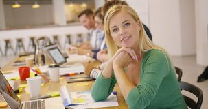 Smiling employee in office royalty free stock image