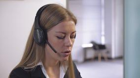 Smiling employee talks on headset. stock video footage