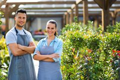 Garden Center Employees. Smiling employees in garden center stock images