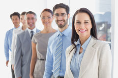 Smiling employees in a line Royalty Free Stock Photography