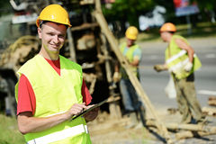 Smiling Engineer builder at road works site. One happy smiling engineer site manager builder with tablet PC at geology roadwork construction site Stock Photos