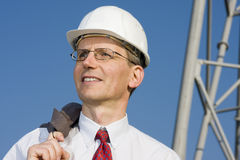 Smiling engineer on construction site Royalty Free Stock Images